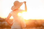 Fotolia: Woman in hat with large fields, at sunset